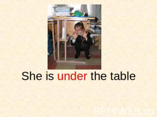 She is under the table