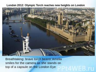 London 2012: Olympic Torch reaches new heights on London Eye Breathtaking: brave