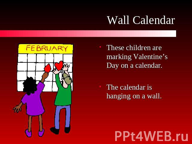 Wall Calendar These children are marking Valentine's Day on a calendar.The calendar is hanging on a wall.