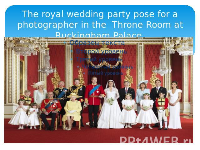 The royal wedding party pose for a photographer in the Throne Room at Buckingham Palace.